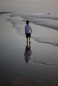 boy on the beach, lonely